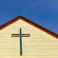 Cross crucifix atop the front facia of a british parish hall nd july st wilfrid s church street kirkby in ashfield nottinghamshire Royalty Free Stock Images