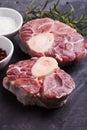 Cross cut veal shank raw fresh slice of meat on a slate board Stock Photo