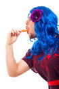 Cross dressing man with ice pop Stock Image