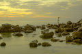 Cross for fisherman on the sea in morning with rocks and mist sri lanka mirissa weligama Royalty Free Stock Photography