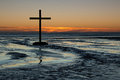 Cross of flowing waters at sunset with water from a stream pass the to the sea Royalty Free Stock Images