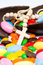 Cross gainst easter chocolate egg and sweets Stock Photography
