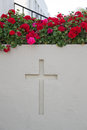 Cross in the garden a religious a planter Royalty Free Stock Photos