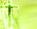 Cross glowing christian on a green nature background Stock Photography