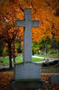 Cross headstone cemetery fall colors a at oak hill in lake geneva wi located in walworth county brilliant yellow from the leaves Royalty Free Stock Photo