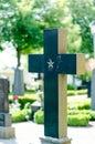 Cross headstone on grave a graveyard Stock Photo
