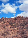 Cross on hill solitary christian top of a Royalty Free Stock Images