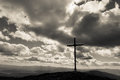 Cross on a hill at sunset black and white dramatic landscape Stock Images