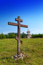 Cross in honor of the basis of church and under construction orthodox church on a hill landscape sunny day Royalty Free Stock Photos