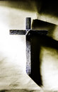 Cross of jesus in warm light with shadow Stock Image