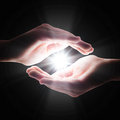 Cross light in the darkness in your hands Royalty Free Stock Photo