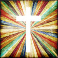 Cross with light shafts faith symbol Stock Photo
