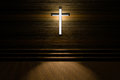 Cross with light shafts. Faith symbol.abstract light of cross religion symbol.cross at the church. Royalty Free Stock Photo