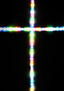 Cross made with several light colors Royalty Free Stock Photo
