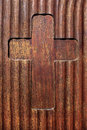 Cross milled in wood that was a slightly corrugated and with brown color varnished wooden board Royalty Free Stock Photos