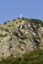 Cross on a mountain top Stock Photos