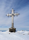 Cross at mountain top in clear winter day russia siberia Stock Photo