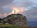 Cross on mountain top colorful coastal sundown scenery a caribbean island named guadeloupe including a summit Stock Image