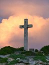 Cross on mountain top colorful sundown scenery a caribbean island named guadeloupe including a summit Stock Photos