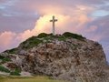 Cross on mountain top colorful sundown scenery a caribbean island named guadeloupe including a summit Royalty Free Stock Photos