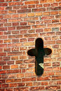 Cross in old brick wall Royalty Free Stock Photo