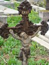 Cross old rusty in a cemetery Stock Photos