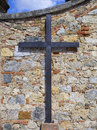 Cross in an old tuscan wall wall Royalty Free Stock Photography