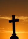 Cross with orange sunset Royalty Free Stock Photos