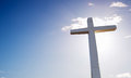 Cross over bright sky background Royalty Free Stock Photo