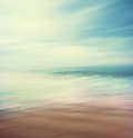 Cross processed sea and sand an abstract time exposure seascape with panning movement image displays a retro vintage look with Royalty Free Stock Photography