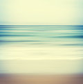 Cross processed seascape an abstract ocean with a blurred panning motion image displays a retro vintage look with colors Stock Images