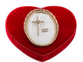 Cross with rings of engagement celebrating th anniversary red heart over white an empty frame and a protestant marriage concept Royalty Free Stock Photos