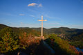 Cross on rock over valley Royalty Free Stock Photo