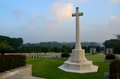 Cross of Sacrifice and tombstones at World War Two soldiers Kranji War Cemetery Singapore Royalty Free Stock Photo