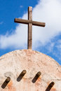 Cross setting on top of old adobe hut Royalty Free Stock Photo