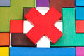 Cross shaped block on wooden puzzle Royalty Free Stock Photo