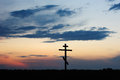 Cross silhouette with the sunset as background Royalty Free Stock Images