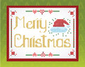 Cross-stitch Christmas  greeting on the wall Stock Photos