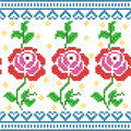 Cross Stitch Embroidery Rose Floral design for seamless pattern texture Royalty Free Stock Photo