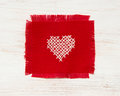 Cross stitched heart on red Royalty Free Stock Photography