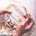 Cross stitching a mature lady doing Stock Images