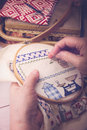 Cross stitching a mature lady doing Royalty Free Stock Image