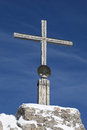 Cross on the summit of a mountain in alps Stock Photography