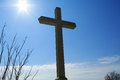 Cross and sun on bright sky Royalty Free Stock Images