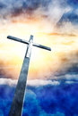 Cross in sunrays against cloudy sky Royalty Free Stock Photography