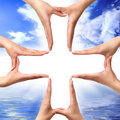 Cross Symbol Made From Hands Stock Photos