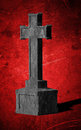 Cross tombstone on bright red background grunge Stock Image
