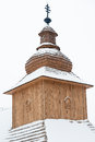Cross on top of greek catholic wooden church in kalna roztoka st basil the great slovakia at winter Royalty Free Stock Image