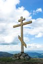 The cross on top of the mountain. Cross against the sky. Wooden cross on a hill. Christian cross. Royalty Free Stock Photo