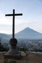 Cross and volcano over Antigua Guatemala valley Royalty Free Stock Photo